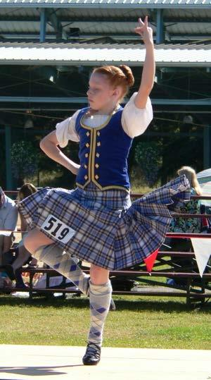 Highland dancer revealing the action of a kilt, worn here with a velvet waistcoat. In Highland dancing, it is easy to see the effect of the stitching on the action of a kilt.