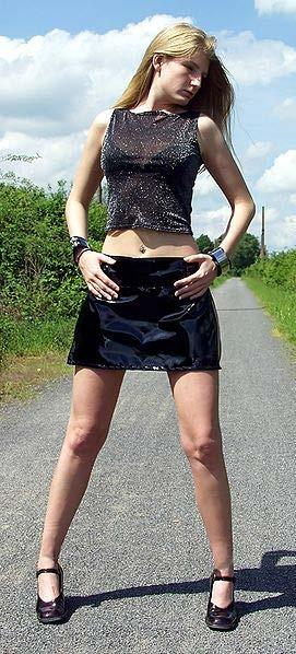 Miniskirt A woman modeling a miniskirt A miniskirt, sometimes hyphenated as mini-skirt, is a skirt with a hemline well above the knees generally no longer than 10 cm (4 in) below the