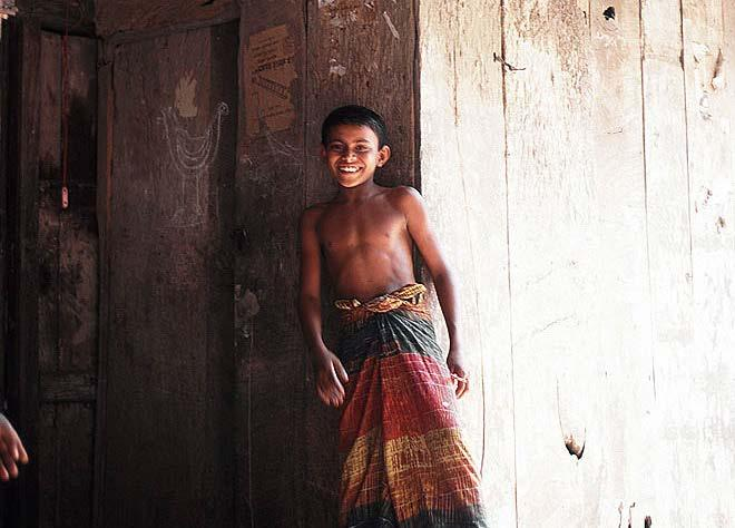 South Asia Bangladeshi boy in a traditional lungi loincloth.