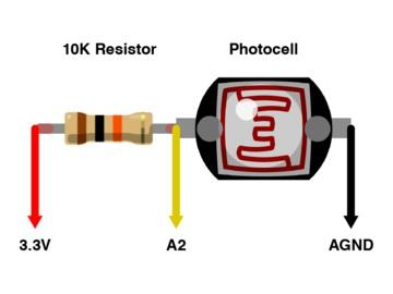 To have the pupils contract or expand in response to light, connect a photocell and 10K resistor in series.