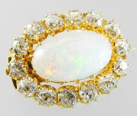 $400 - $600 Lot # 414 414 19k brooch set with a pearl.