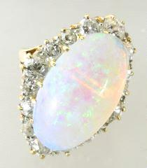 $1,000 - $2,000 418 18k opal and diamond ring.
