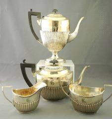 490 491 Lot # 476 476 Four piece Birks sterling silver tea and coffee service. $500 - $750 492 493 494 Ladies' 18k gold ring set with 4.8x3.7x1.