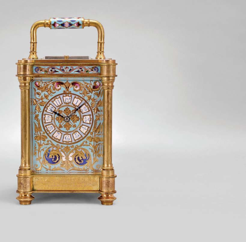 651 France, an unusual, champlevé enamel decorated, pillars style hour repeating carriage clock, the gilt case with outset corners, turned feet and columns, the base, frieze, and top with scrolling