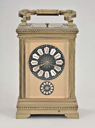 7, 1897, Roman numeral white enamel dial with gilt mask and subsidiary alarm dial, blued steel hands, 8 day, time, strike and alarm movement with lever platform, sounding the quarters in passing, and