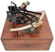 vernier adjustment, index with magnifier and frosted glass shade, multiple shades for index and horizon mirrors, three sighting telescopes, and hardwood handle, all in a felt-lined finger-jointed