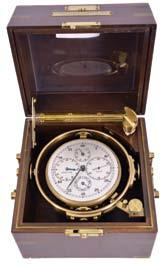 freesprung, cut bimetallic balance, diamond endstone, and helical balance spring, Roman numeral silvered dial with wind indicator and gold spade and poker hands, with gimballed, lacquered brass bowl,