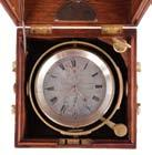 spring, Roman numeral silvered dial with wind indicator and gold spade and poker hands, with gimballed, lacquered brass bowl, and contained in a later, three tier mahogany box with brass furniture,