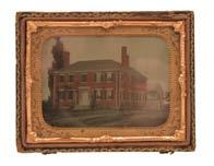 Antiques 607 Tinted ambrotype, image of a red brick New England dwelling with hip roof, three chimneys, clapboard ell and barn, a pair of tapered, white painted, chevron pattern trellises flanking