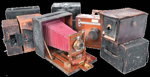 Many antique cameras including Kodak Brownie models, a Kodak