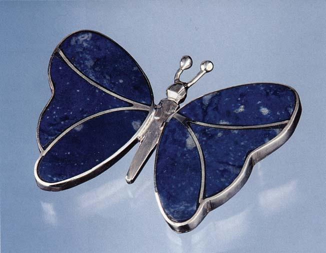 Figure 1. Chilean lapis lazuli is currently used in a variety of ways, but the finer-quality material is incorporated into jewelry. This sterling silver brooch (3.8 2.