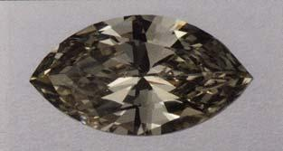 These two diamonds, 0.74 (top) and 31.10 ct, are typical of the yellowish green to greenish yellow colors seen in chameleon diamonds. heated.