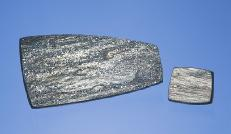 Figure 8. Tablets of specular hematite (left) and drusy hematite (right) from Arizona were among the unusual gem materials seen at Tucson this year. The large piece measures 53.4 28.0 4.