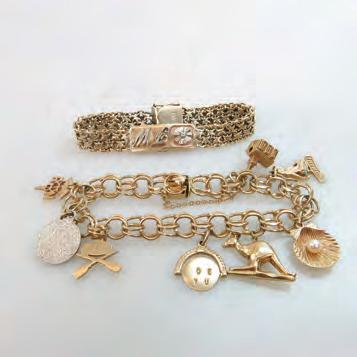 139 10K YELLOW GOLD CHARM BRACELET set with 8 various gold and metal charms; with 10k