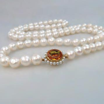 295 SINGLE STRAND OF FRESHWATER PEARLS completed with an 18k yellow gold clasp set with an