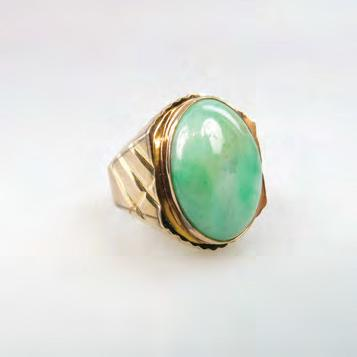337 14K YELLOW GOLD RING bezel set with an oval jadeite cabochon (20.5mm x 14.8mm), size 10, 13.