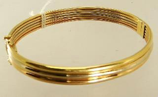 Lot # 438 Lot # 451 438 18k yellow tri gold hinged bracelet.