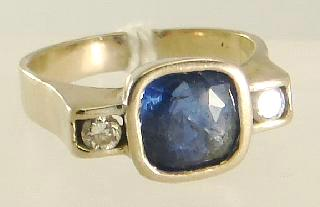 Lot # 459 459 18k white gold sapphire and diamond ring, sapphire approx. 4.38cts, dia. approx. 0.33cts.