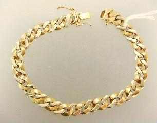 532 533 534 535 Lot # 514 514 515 516 517 518 519 520 521 522 523 524 525 526 14k yellow and white gold curb link bracelet.