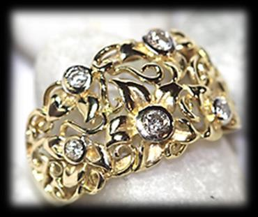 Estimate: R3,000 R5,400 69 18 carat yellow and white polished gold classic diamond RING of broad design.
