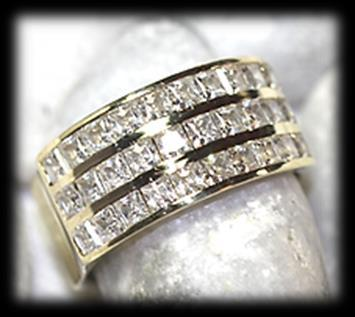 77 9 carat yellow polished gold cubic zirconia RING of modern broad design.