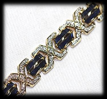 Estimate: R700 R1,300 83 18 carat yellow polished gold diamond and sapphire BRACELET of classic design.