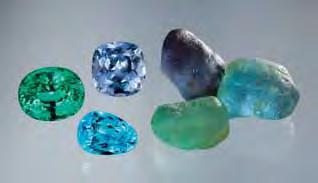 Figure 19. Mozambique Cu-bearing tourmaline pebbles commonly are of a single color, yielding cut stones with even color distribution (here, 6.75 15.77 ct). All but the blue faceted stone are unheated.