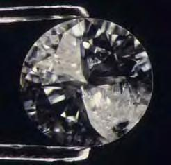 Figure 16. Introduction of a glass filler into this 0.30 ct diamond s cleavage cracks produced a dramatic change in apparent clarity (before filling, left; after filling, right).