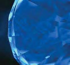 Figure 7. These Diamond- View images reveal the banded appearance of blue fluorescence in the faceted diamonds. In the 0.