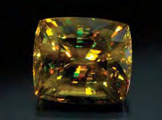 Figure 3. This 76.27 ct sphene is notable for its large size and vibrant display of dispersion. Courtesy of H. Obodda, Short Hills, New Jersey; photo by Robert Weldon.