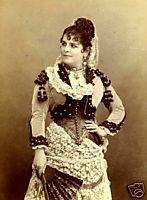 Picture 2: The singer Galli Marie in her role of Carmen wearing a stage version of Spanish dress with high comb The singer is obviously wearing a very fanciful version of Spanish costume in her role.