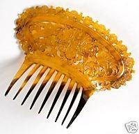 Picture 5: Tortoishell mantilla style comb with elaborate pique decoration A very beautiful and grand mantilla style hair comb from this period is shown in picture 5.