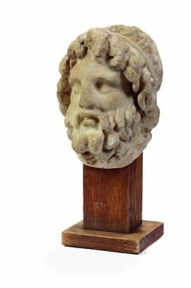 140 a roman marble head of the Greek-roman god serapis, his basket attribute on his head is