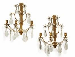 162 a pair of baroque style rock crystal and brass three light wall lights. c. 1900. H 38 cm.