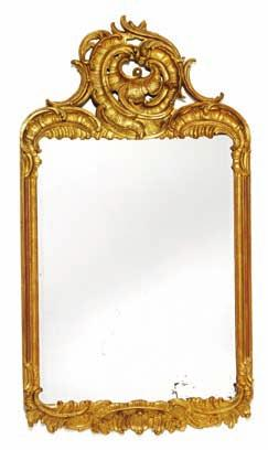 167 a south German rococo giltwood mirror, carved with openwork rocailles and foliage, beveled mirror glass. Mid 18th century. H. 133 cm. W.