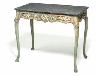 DKK 8,000-10,000 / 1,050-1,350 172 An Italian painted table with faux marble top and openwork apron carved with flowers and foliage, cabriole legs, claw and ball. 19th century, restored.