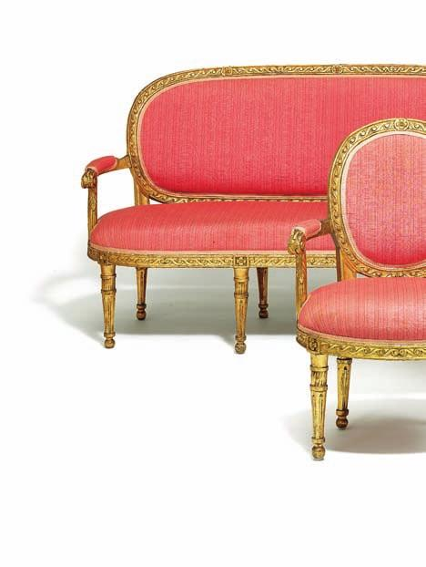 180 a fine danish louis XVi set of giltwood seat furniture, consisting of a sofa and four armchairs, round backs and seats, carved with running dog pattern, round tapered fluted legs. 18th century. l. 176 cm.