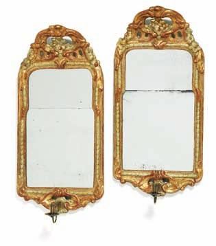 186 186 a pair of signed rococo giltwood bracket mirrors, each with one brass arm for candle. Marked ns for nils sundström b. stockholm 1727, d. 1781 and received a royal priviledge in 1757.