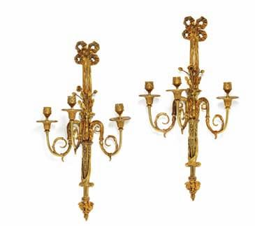 201 a pair of swedish gilt bronze wall light, each with three curved arms for candles, molded with openwork bows,