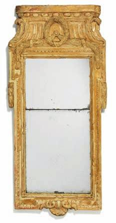 203 a Gustavian partly giltwood mirror, carved with foliage and festoons. Marked cc.