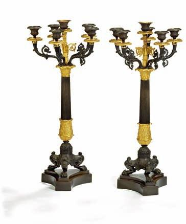 245 a pair of large french charles X gilt and patinated bronze candelabra, each with six curved arms for candles, fluted stems on tripod bases. france, mid 19 century. H. 67 cm.