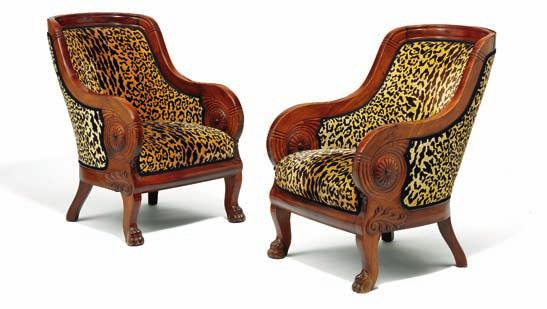 247 247 a pair of large mahogany bergere, both with arched backs and sides carved with rosettes and forliage,