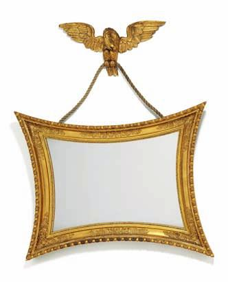 263 a swedish empire giltwood and gezzo mirror with concave sides, hanging with eagle. c. 1830. H.