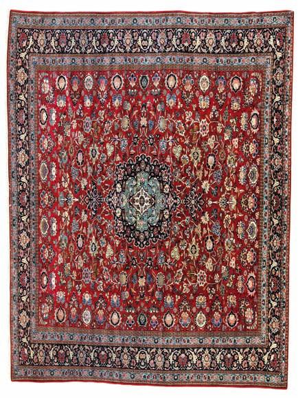 298 298 a Keshan, persia. classical medallion design on a red field of rosettes, flowers and foliage. Knotted with kork wool and highlights with silk pile.