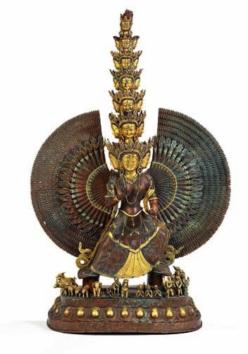 327 Buddhist part gilt large copper figure of avalokiteshvara with numerous arms and 19 heads, standing on a base with boddhisatvas and animals. 20th century. H. 120 cm.
