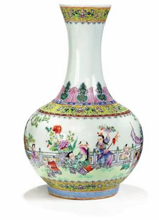 335 335 Chinese porcelain balustervase, decorated in colours with playing children in scenery.