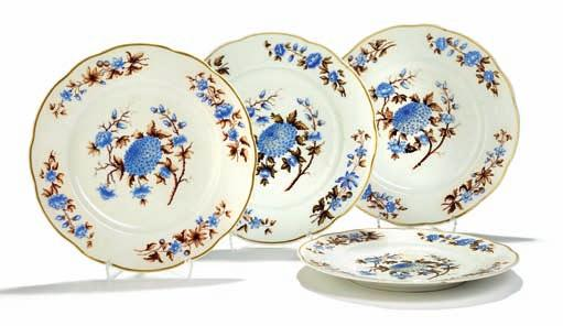 370 370 Four russian porcelain plates with lobed rim, decorated in colours and gold with blue flowers on white ground.