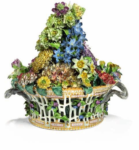 "419 419 ""Flora danica"" porcelain flower centrepiece, decorated in colours and gold in the form of pierced basket with arrangement of repoussé flowers, twisted"