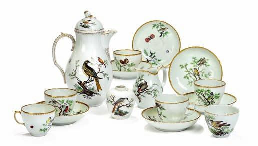"421 421 ""The bird service"" decorated in colours and gold with exotic birds on branches and insects, comprising of; 6 cups, 6 saucers, creamer, teacaddy and coffee-pot."