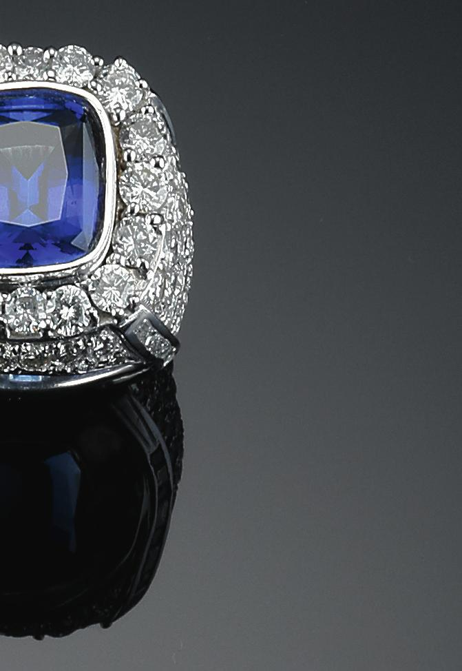 518 a tanzanite and diamond ring set with a cushioncut tanzanite weighing app. 13.00 ct. and numerous brilliant-cut diamonds weiging a total of app. 11.30 ct., mounted in 18k white gold. size 66.5. weight 58 gr.